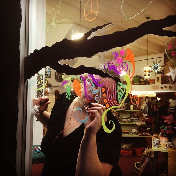 Photo of me drawing on a window. Photo by Janet Dawson.
